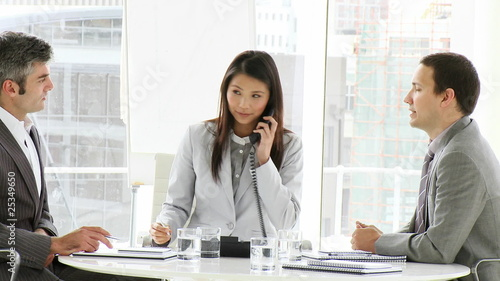 business people on phone during a meeting