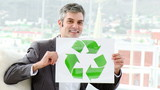 Positive businessman showing the concept of recycling