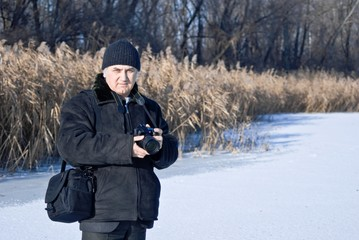 photographer on a frozen river