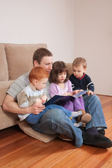 Dad reading story to kids