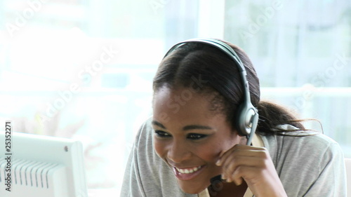 charming african woman wearing headset