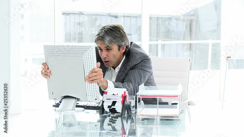 Disconsolate businessman working at a computer