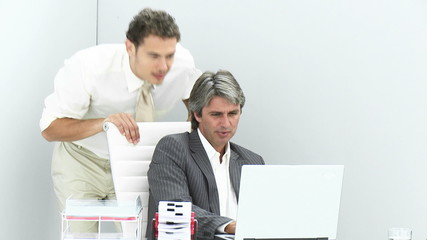 young businessman assisting his manager