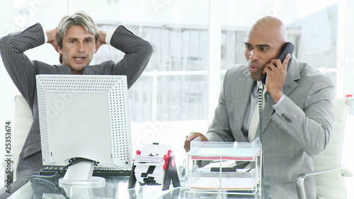 frustrated businessmen at work
