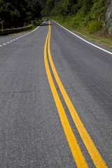 scenic country road curves through Shenandoah  National Park.