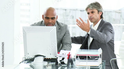 confused businessmen in front of a computer