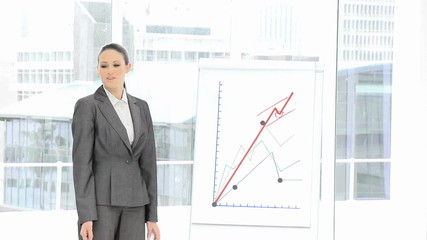 young female executive showing graphs