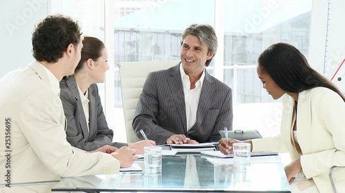 group of executives having a discussion sitting at a table