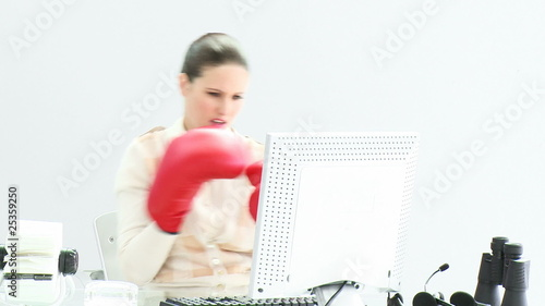 elegant business woman punching her computer