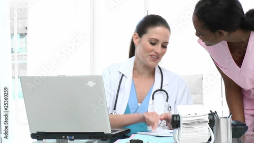 attractive doctor giving notes to nurse