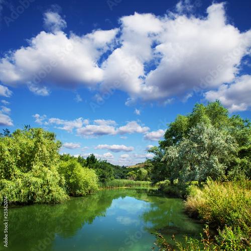 summer landscape, river and blue sky