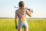Girl with  pneumatic air  rifle