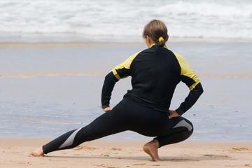 exercising girl, preparing for surfing