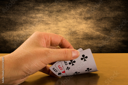 risk and success . Player hand revealing triple six Obraz na płótnie
