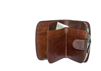 Dollars in a brown women's purse isolated on white background