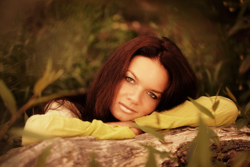 Woman recline on tree