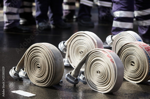Leinwanddruck Bild rolled up hoses, prepared for a fire fighter competition