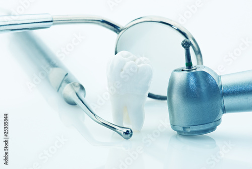 Real human wisdom tooth and dental tools.