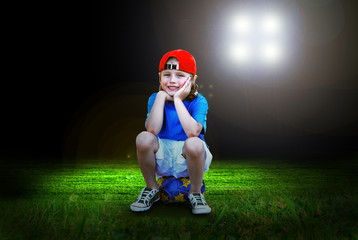 Happiness young boy on the field of stadium with light