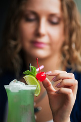 Young woman with cocktail.