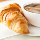 Fototapety Croissant and a cup of delicious coffee