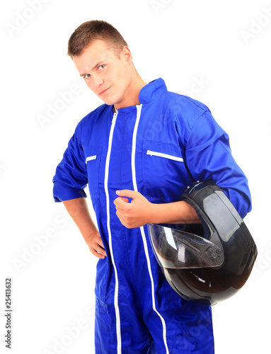 motorcyclist in blue coveralls with black helmet
