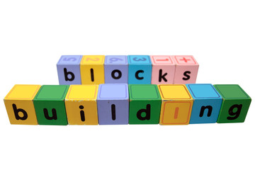 building blocks in toy play block letters against white