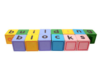 building blocks in wood play block letters against white