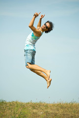 man jumping on sky background