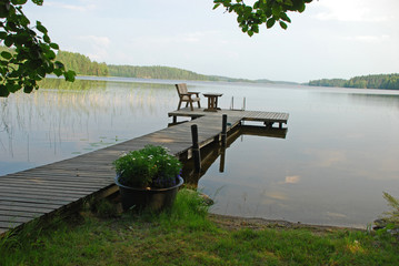 Foot-path in the border of a lake in Central Finland