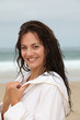 Happy woman on the beach during spa treatment