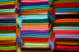 A cikkection f colorful fabric of different patterns and sizes