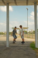 Two boys skateboarding.