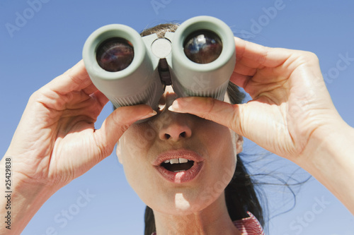 italy, south tyrol, woman using binoculars, portrait, close-up