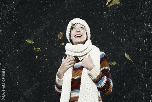 woman enjoying in rain, smiling, looking up.
