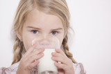 germany, cologne, girl (4-5) drinking glass of milk, portrait, close-up