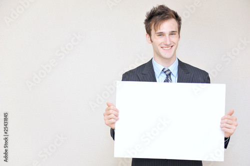 young business man holding a white board,