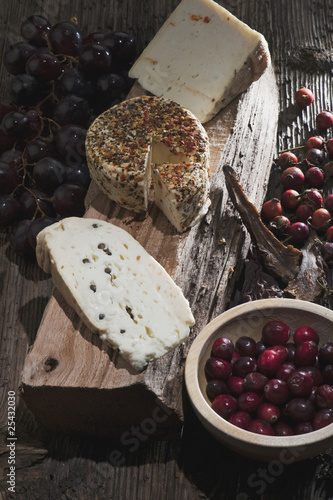 austria, salzburg, goat cheese, slice of bread and grapes in bowl, elevated view