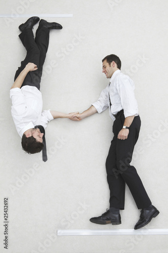 businessmen shaking hands, smiling, portrait, elevated view