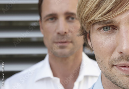 germany, cologne, two businessmen, staircase in background, portrait, close up