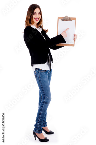Business woman pointing on a blank clip board