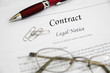 legal contract papers with pen and glasses