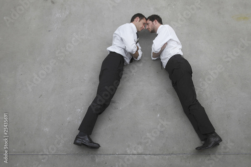 two businessmen standing opposite to opposite, portrait, elevated view