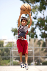 Young basketball player jumping high