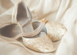 Beautiful luxury white wedding shoes with pearl necklace - 25436869