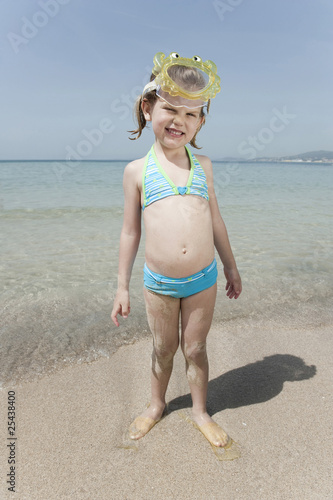 spain, mallorca, girl (4-5) on the beach wearing diving goggles, portrait