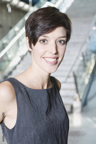 germany, bavaria, munich, business woman at subway station, smiling, portrait, close-up