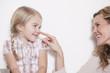 Deutschland, Mutter und Tochter, Mutter berühren Nase, lächeln, Porträt