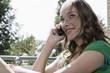 Deutschland, Frau jung auf dem Balkon, mit Handy, Portrait, close-up