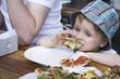 Deutschland, Junge Kleinkind Stück Pizza essen im Freien, Portrait